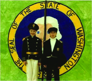 Clay and Nathan by their state seal, a WA state history report on early explorers to the PNW for the state centennial in 1989.