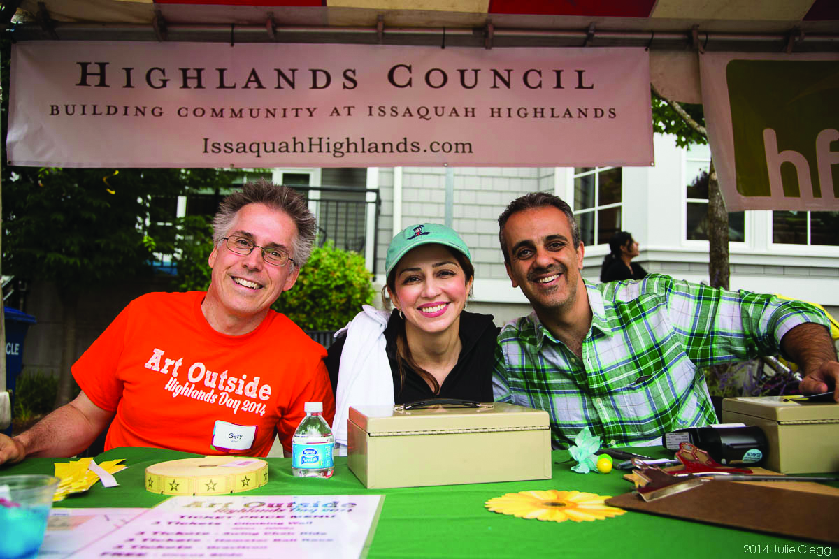 Gary Ashby working at Highlands Day in 2014 with Dr. Shadi and Dr. Ray from Highlands Dentistry, also volunteering.