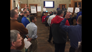 The community gathered at Blakely Hall for the City of Issaquah's first Tackling Traffic Open House. The Traffic Task Force led the meeting, Issaquah Highland resident Geoffrey Walker (front of room, right) serves at vice-chair.