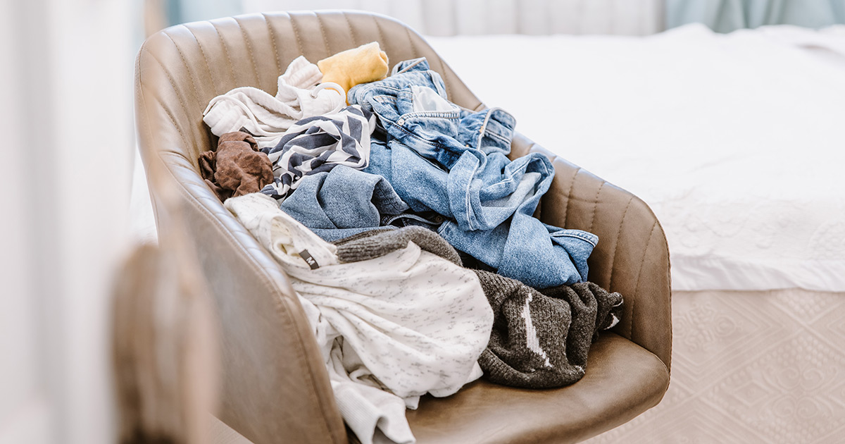 Clothing piled on chair