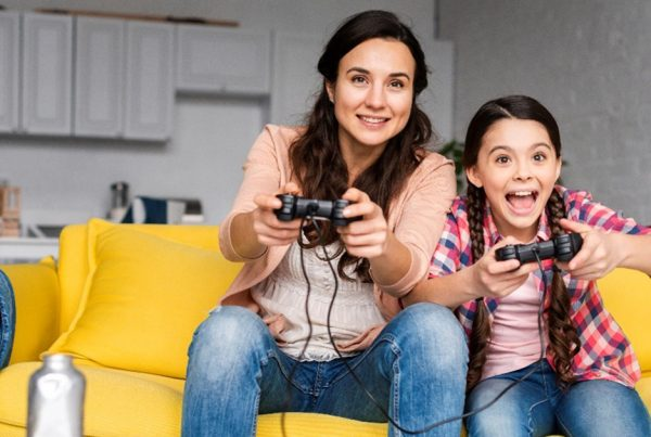 Woman and child play vidoe games
