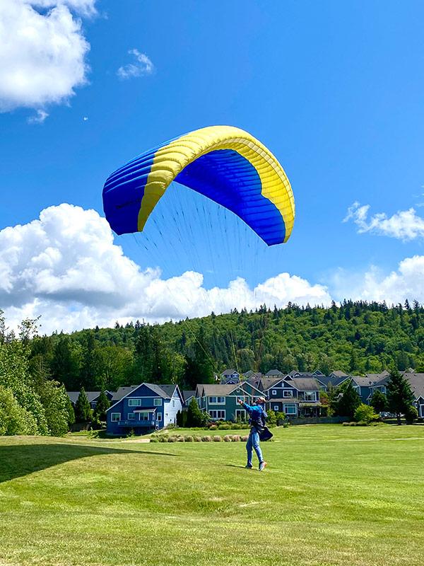 Ami Desai-Mehta Grand View Park paraglider landing